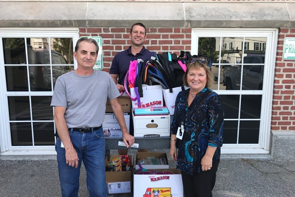 NHHEAF Network Cares committee members Phil and Bianca deliver our donations of school supplies to Manchester's Bakersville School in September 2019.